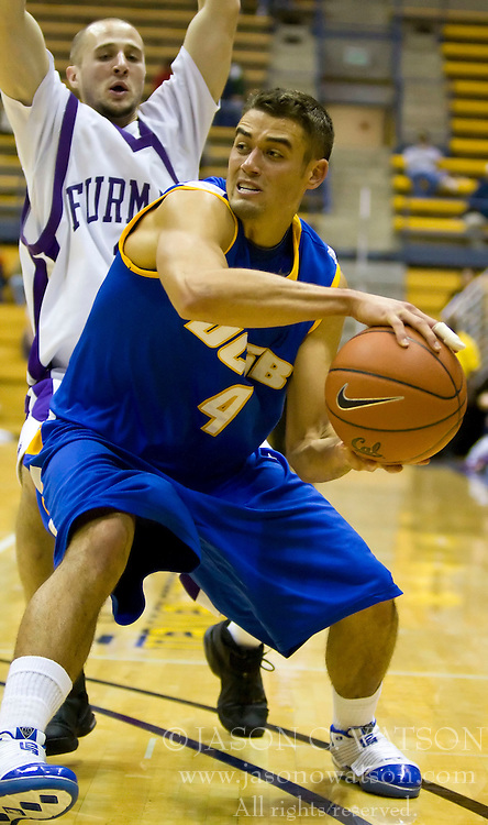 December 28, 2009; Berkeley, CA, USA;  UC Santa Barbara Gauchos guard Paul Roemer (4) is guarded by Furman Paladins guard Justin Dehm (1) during the second half at the Haas Pavilion.  UC Santa Barbara defeated Furman 72-60.