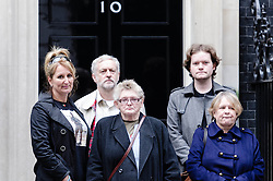 © Licensed to London News Pictures. 07/10/2012. London, UK. Caroline  Munday (1st from Left), Joan Humphreys (3nd from Left), Jeremy Corbyn (2rd from Left) and others deliver a letter to the Prime Minister at Number 10 Downing Street asking that he withdraw British troops from Afghanistan by the end of the year.   This followed a protest against the war in Afghanistan held at Trafalgar Square by the Stop the War Coalition. Those who attended included Caroline Munday (mother of Trooper James Munday who was killed serving in Afghanistan in 2008), Joan Humphreys (grandmother of Private Kevin Elliott of the Blackwatch regiment who was killed serving in Afghanistan in 2009) Jeremy Corbin MP, Paul Flynn MP, Kate Hudsen of CND, musician Brian Eno, and John Rees of Stop the War.  Photo credit : Richard Isaac/LNP