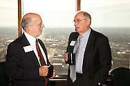 Gary L. Froelich of the Froelich Law Office (left) and .David L. Neer of  of Merrill Lynch Wealth Management during the Dayton Area Chamber of Commerce Breakfast Briefing at the Dayton Racquet Club in downtown Dayton, Friday, July 13, 2012.