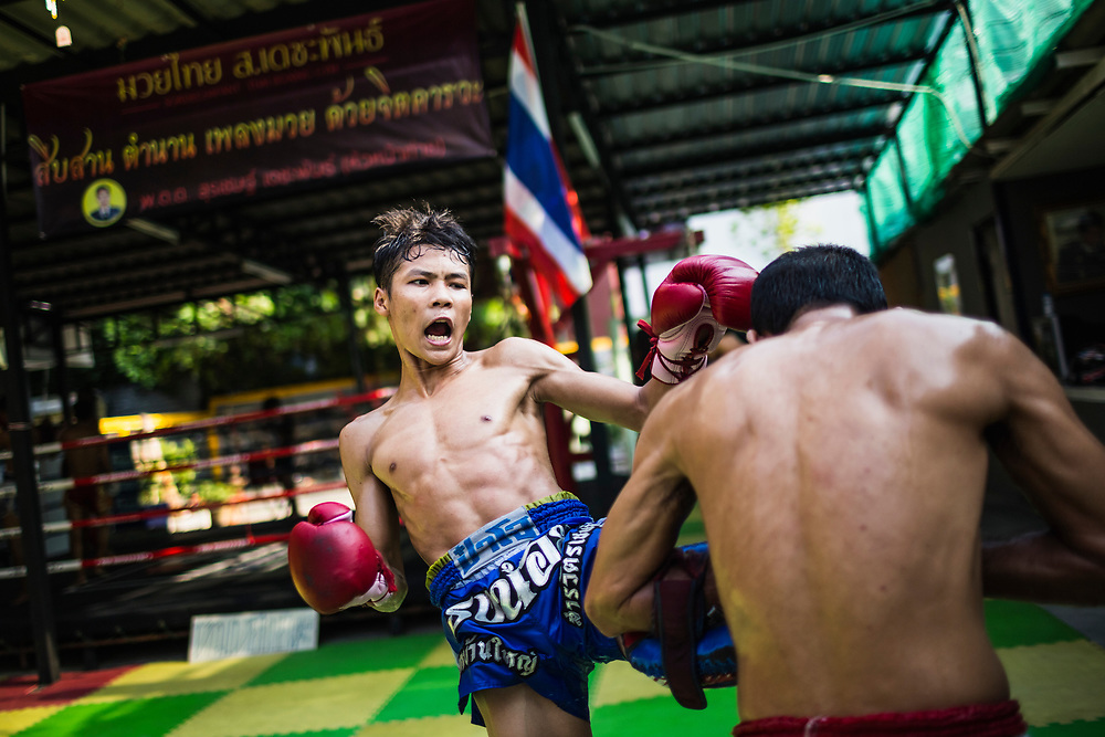 Young Thai boys go through intense Muay Thai training at Sor Dechapant Gym in Bangkok, Thailand. In recent years, combat sports--especially Muay Thai--have been seen as a crucial elements in successful Mixed Martial Arts fighting.