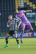 Plymouth Argyle defender Kelvin Mellor  battles with Notts County forward Graham Burke during the Sky Bet League 2 match between Notts County and Plymouth Argyle at Meadow Lane, Nottingham, England on 11 October 2015. Photo by Simon Davies.