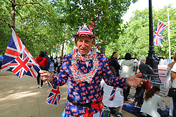 © Licensed to London News Pictures. 09/06/2018. London, UK. Royal fans wait to see members of the Royal family attend Trooping The Colour ceremony in London to mark the 92nd birthday of Queen Elizabeth II, Britain's longest reigning monarch. Photo credit: Rob Pinney/LNP