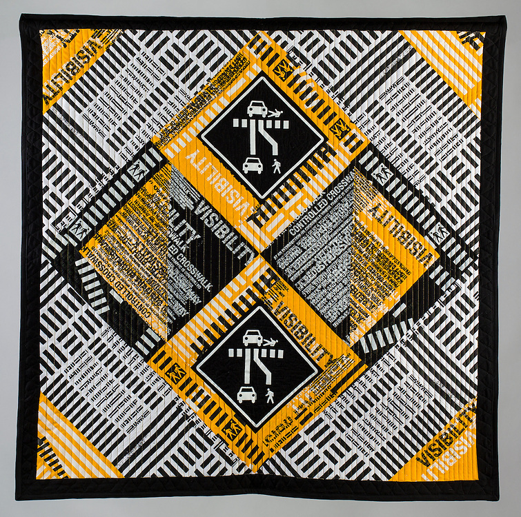 Sewn cloth quilt by Stephen Driscoll Hixson. 36 inches by 36 inces.