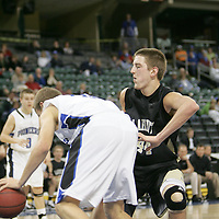 Lafayette center Luke Kreienkamp attempts to stop a pioneer player from scoring under his basket.
