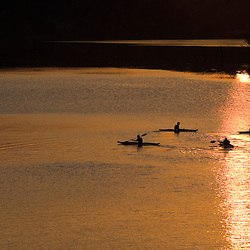 Four kayakers on the West River at sunset in Brattleboro, Vermont.  Near the river's confluence with the Connecticut River.
