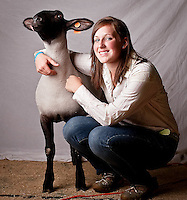 """JEROME A. POLLOS/Press..Kurryn Muhlhauser's mother and sister were involved in 4-H, so Kurryn decided to continue the tradition for the past eight years showing sheep and steer. Bubbs, a 6-month-old Suffix cross was awarded a grand champion ribbon for market, just beating out her sister Jordyn who won a reserve ribbon. """"It takes a lot of time to keep up on their diet, working with them and making sure they get their exercise,"""" the 15 year old said."""