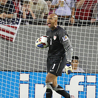 USA Goalkeeper Tim Howard (1)  screams during a CONCACAF Gold Cup soccer match between the United States and Panama on Saturday, June 11, 2011, at Raymond James Stadium in Tampa, Fla. (AP Photo/Alex Menendez)