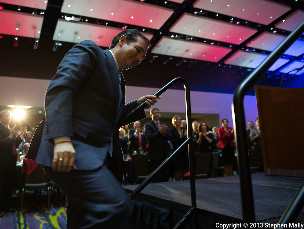 DES MOINES, IA - OCTOBER 25, 2013: Senator Ted Cruz, Republican of Texas, walks up to the stage to speak at the Iowa GOP Ronald Reagan Dinner at the Iowa Events Center - Community Choice Credit Union Convention Center in Des Moines, Iowa.