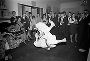 16/2/1966<br /> 2/16/1966<br /> 16 February 1966<br /> <br /> Guests at the Beamish and Carling Reception for the All Ireland Judo Championships held at the Jurys Hotel watching Paddy Matthews(Dublin Judo Club) Throwing his opponent Robert Farrell.