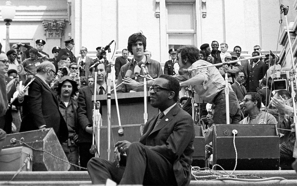 On April 22, 1971, Vietnam veteran Lt. John Kerry became the first Vietnam veteran to testify before Congress about the war, when he appeared before a Senate committee hearing on proposals relating to ending the war.<br /> Kerry is shown here as he prepares to speak on the U.S. Capitol steps the day after his testimony - April 23, 1971 - as he participated in a demonstration with thousands of other veterans in which he and other veterans threw their medals and ribbons over a fence erected at the front steps of the United States Capitol building to dramatize their opposition to the war. - To license this image, click on the shopping cart below -