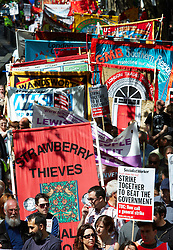 © licensed to London News Pictures. LONDON, UK  01/05/2011. Around 5,000 people walk from Clerkenwell to Trafalgar Square for the traditional May Day worker march. A discreet but large police presence followed behind. Please see special instructions for usage rates. Photo credit should read CLIFF HIDE/LNP