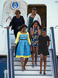 © Licensed to London News Pictures. 15/06/2015. Stansted, UK. First Lady MICHELLE OBAMA arrives in the UK at Stansted Airport accompanied by her mother, Marian Robinson, and daughters Malia and Sasha for the start of a three day visit to the UK. During the visit the First Lady and her family will meet with students at Mulberrry School for Girls and have Tea with Prime Minister David Cameron and Samantha Cameron. Photo credit: Ben Cawthra/LNP