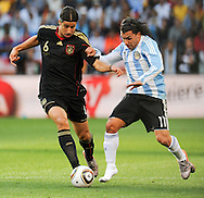 CAPE TOWN, SOUTH AFRICA- Saturday 3 July 2010, Carlos Tevez (without shoes) challenges Sami Khedira during the quarter final match between Argentina and Germany held at the Cape Town Stadium in Green Point during the 2010 FIFA World Cup..Photo by Roger Sedres/Image SA