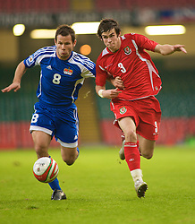 CARDIFF, WALES - Saturday, October 11, 2008: Wales' Gareth Bale and Liechtenstein's Ronny Buchel during the 2010 FIFA World Cup South Africa Qualifying Group 4 match at the Millennium Stadium. (Photo by Gareth Davies/Propaganda)