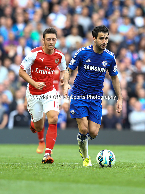 5 October 2014 - Barclays Premier League - Chelsea v Arsenal - Cesc Fabregas of Chelsea in action with Mesut Ozil of Arsenal - Photo: Marc Atkins / Offside.