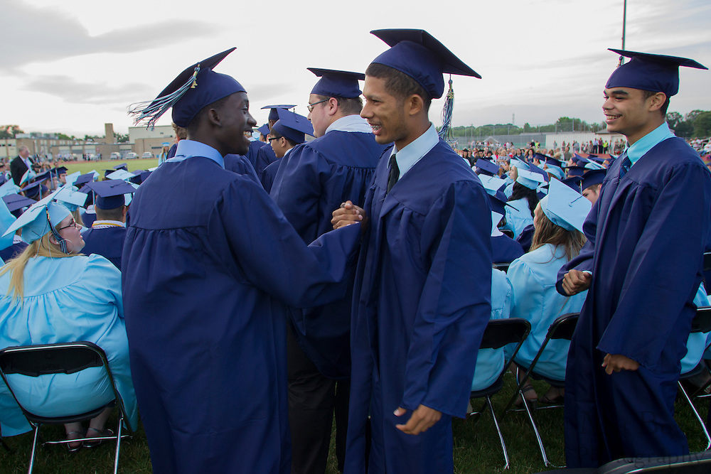 Justin Ward (right) greets Ta'von Juston Wade while waiting to receive their diplomas during Highland Regional High School graduation on Thursdays June 14, 2012 . (photo / Mat Boyle)