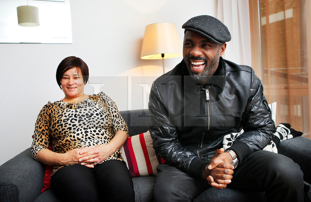 © under license to London News Pictures. Actor Idris Elba with new resident Pat Benjamin during the opening of Elba House, a new social housing development in Andre St, Hackney on 14th january 2011 . The new block is named after the Wire and Luther actor. Photo credit should read: Olivia Harris/ London News Pictures