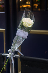 "Compton Street, Soho, London, June 13th 2016. A pair of white roses, a solemn memorial to the 50 people killed at gay club Pulse in Orlando on 12 June, is attached to the balustrade outside The Admiral Duncan, a LGBT-friendly bar that knows too well the price of homophobia, bombed by Neo-Nazi David Copeland on 30 April 1999, killing three people and wounding 70. The message on the card reads, ""Compton Street, Soho, London, June 13th 2016. A pair of white roses, a solemn memorial to the 50 people killed at gay club Pulse in Orlando on 12 June, is attached to the balustrade outside The Admiral Duncan, a LGBT-friendly bar that knows too well the price of homophobia, bombed by Neo-Nazi David Copeland on 30 April 1999, killing three people and wounding 70. The message on the card reads, ""To Orlando, LOVE IS LOVE! Soho stands with you."" and is signed ""James and Talia""."