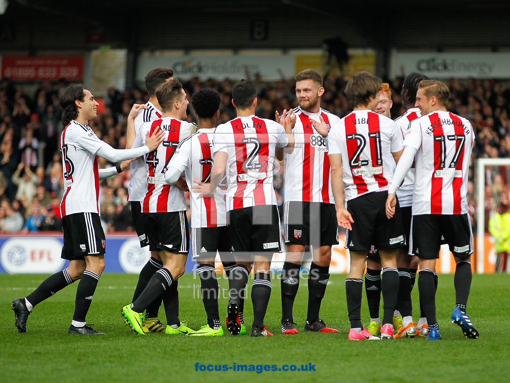 Lasse Vibe of Brentford celebrates scoring the second goal with his tream mates during the Sky Bet Championship match between Brentford and Bristol City at Griffin Park, London<br /> Picture by Mark D Fuller/Focus Images Ltd +44 7774 216216<br /> 01/04/2017