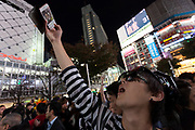 A young Japanese man in costume takes a selfie at Hachiko Square during the Halloween celebrations in Shibuya, Tokyo, Japan. Wednesday October 31st 2018 .  Halloween has grown massively popular  in Japan over the last few yers. Primarily an event for young adults who use it as a chance to dress up in inventive costumes and spend the night partying . In recent years the misbehaviour of some revellers has caused a heavier police presence on the street and  a push back from the Japanese society, and media  who see no need for nor benefits to this western cultural import.