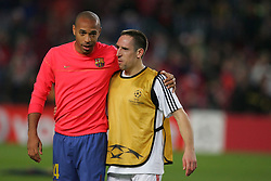 Thierry Henry of Barcelona and Frank Ribery of Bayern Munich talk before the UEFA Champions League quarter final first leg match between FC Barcelona and FC Bayern Munich at the Camp Nou stadium on April 8, 2009 in Barcelona, Spain.