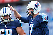 NASHVILLE, TN - OCTOBER 25:  Zach Mettenberger #7 pats Andy Gallik #69 of the Tennessee Titans on the helmet before a game against the Atlanta Falcons at Nissan Stadium on October 25, 2015 in Nashville, Tennessee.  The Falcons defeated the Titans 10-7.  (Photo by Wesley Hitt/Getty Images) *** Local Caption *** Andy Gallik; Zach Mettenberger