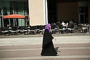 Woman in abaya at Dubai Mall  in Dubai, UAE on February 10, 2010 Archive of images of Dubai by Dubai photographer Siddharth Siva