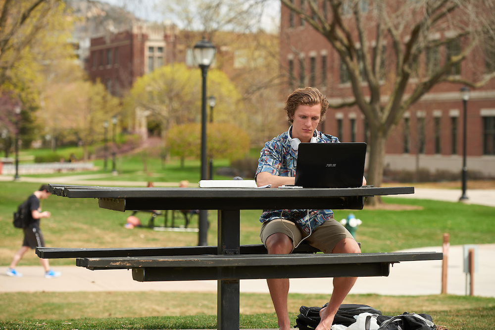 Activity; Studying; Drake Field; Location; Outside; Objects; Computer; People; Student Students; Spring; April; Time/Weather; sunny; Type of Photography; Candid; UWL UW-L UW-La Crosse University of Wisconsin-La Crosse; Men man Marcus jones accounting and finance