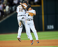 Omar Vizquel celebrates the Giants' win with third baseman Jose Castillo in his first game back in Cleveland.