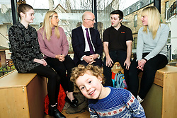 Pictured: Four year old Theo LaCroix photobombed Mr Swinney as he met modern apprentices Kayleigh Singer (grey jumper); Georeg McArthur (pink jumper), Holly Whitehead (black and white dress) and Jake Stefanovic, an ambassador from the Scottish Government&rsquo;s childcare recruitment campaign.<br /> Deputy First Minister John Swinney visited Cowgate Nursery in Edinburgh to meet children, staff and modern apprentices working in early years and childcare. Mr Swinney confirmed that a record number of early years apprenticeships are expected to start this year as part of the expansion of free nursery and childcare.  Mr Swinney toured the nursery and discussed the City of Edinburgh Council&rsquo;s plans to expand the early years and childcare workforce and met with modern apprentices as well as Jake Stefanovic, an ambassador from the Scottish Government&rsquo;s childcare recruitment campaign.<br /> <br /> <br /> Ger Harley | EEm 13 February 2018