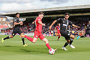 York City forward Reece Thompson takes on Mansfield Town defender Ryan Tafazolli  during the Sky Bet League 2 match between York City and Mansfield Town at Bootham Crescent, York, England on 29 August 2015. Photo by Simon Davies.