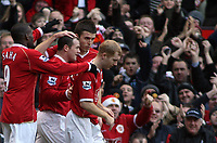 Photo: Paul Thomas.<br /> Manchester United v Manchester City. The Barclays Premiership. 09/12/2006.<br /> <br /> Wayne Rooney and Man Utd celebrate his opening goal.
