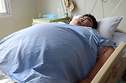 RIZHAO, CHINA - APRIL 14: (CHINA OUT) <br /> <br /> 300kg Man Is Hospitalized For Multiple Organ Failure<br /> <br /> 22-year-old Sun Liang, more than 300 kg in weight, lies at ICU on April 14, 2014 in Rizhao, Shandong Province of China. Sun Liang was hospitalized for multiple organ failure on April 9. Sun suddenly started to grow at the age of 19. He gained 150kg to more than 300kg in following three years.<br /> ©Exclusivepix