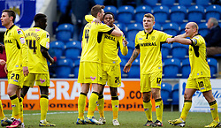 COLCHESTER, ENGLAND - Saturday, February 23, 2013: Tranmere Rovers' Jean-Louis Akpa Akpro celebrates scoring the second goal against Colchester United with team-mates Ash Taylor, Zoumana Bakayogo, captain Andy Robinson and Max Power during the Football League One match at the Colchester Community Stadium. (Pic by Vegard Grott/Propaganda)