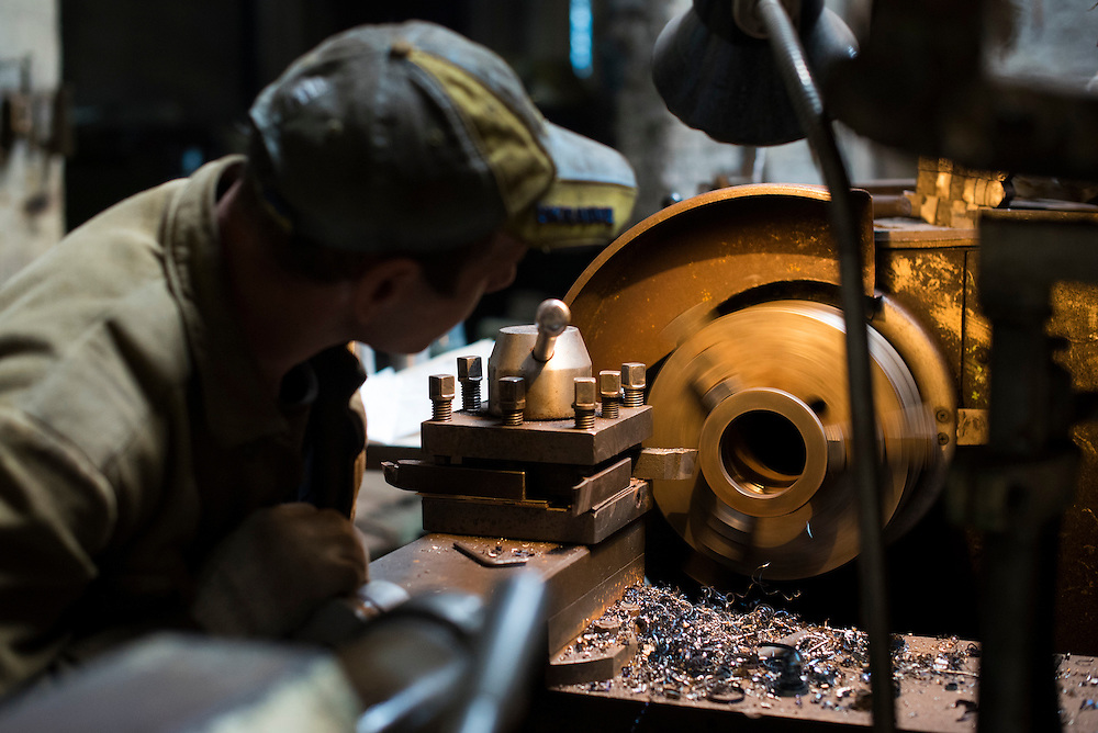 A member of Azov Engineering Group uses a lathe on September 9, 2015 in Kyiv, Ukraine.