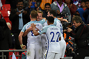 England forward Harry Kane (facing) celebrates with team mates after scoring a goal (1-0) during the FIFA World Cup Qualifier match between England and Slovenia at Wembley Stadium, London, England on 5 October 2017. Photo by Martin Cole.