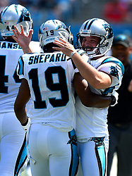 September 17, 2017 - Charlotte, NC, USA - Carolina Panthers wide receiver Russell Shepard, left, is congratulated by punter Michael Palardy, right, after Shepard knocked the ball down inside the five-yard line during second quarter action against the Buffalo Bills on Sunday, Sept. 17, 2017 at Bank of America Stadium in Charlotte, N.C. The Panthers defeated the Bills 9-3. (Credit Image: © Jeff Siner/TNS via ZUMA Wire)