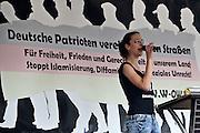 Frankfurt am Main | 20 Jun 2015<br /> <br /> Kundgebung der islamfeindlichen Gruppe &quot;Widerstand Ost West&quot; (WOW) um Ester Seitz, die Rechtspopulisten, rechte Hooligans und Neonazis vereint, auf dem Rossmarkt.<br /> Hier: Ester Seitz, Anmelderin der der WOW-Demo, h&auml;lt eine Rede.<br /> <br /> Photo &copy; peter-juelich.com