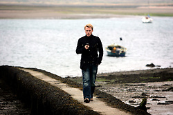 IRELAND DUBLIN 9MAY06 - Singer Ronan Keating (29) checks is mobile phone at Malahide marina, near his current residence in his native Dublin. The popstar emerged on the international scene in 1994 with the band Boyzone and has since gone solo and is about to release his new album 'Bring You Home' in June this year...jre/Photo by Jiri Rezac..© Jiri Rezac 2006..Contact: +44 (0) 7050 110 417.Mobile:  +44 (0) 7801 337 683.Office:  +44 (0) 20 8968 9635..Email:   jiri@jirirezac.com.Web:    www.jirirezac.com..© All images Jiri Rezac 2006 - All rights reserved.