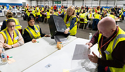 Edinburgh, Scotland, UK. 12th December 2019. Box containing postal votes emptied onto table at Parliamentary General Election Count at the Royal Highland Centre in Edinburgh. Five constituencies are being counted in Edinburgh, Edinburgh West, Edinburgh South West, Edinburgh North & Leith, Edinburgh South and Edinburgh East. Iain Masterton/Alamy Live News