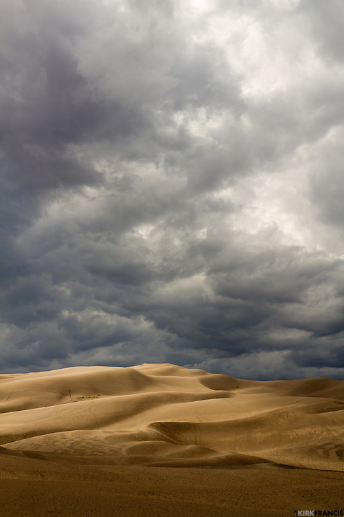 This day at the Great Sand Dunes National Park in Colorado, there were scattered thunderstorms that created interesting lighting and coloring of the sand.