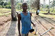 Gedeon Kalenga, a member of a community nutrition group in Masi Manimba, DRC. The community fields provide food for 35 local families, but they only have two watering cans to irrigate their crops.
