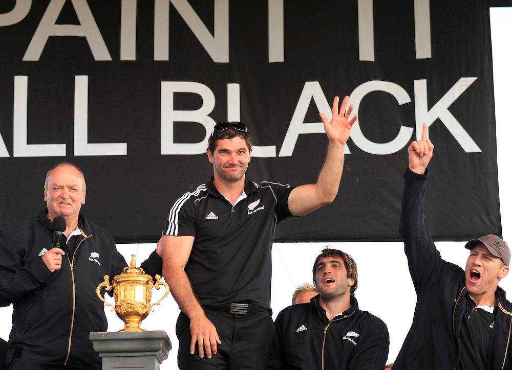 New Zealand's coach Graham Henry,  left, and Steven Donald onstage at the welcome for the All Black's after New Zealand won against France in the Rugby World Cup final, Christchurch, New Zealand, Tuesday, October 25, 2011. Credit:SNPA / Pam Johnson