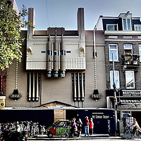 """Nederland, Amsterdam , 27 augustus 2014.<br /> Het Ceintuur theater gaat per 1 november 2014 weer open.<br /> Na een renovatie van bijna 1 jaar hoopt de nieuwe huurder van het café restaurant weer een echte ontmoetingsplek in de buurt te maken.<br /> n opdracht van de Kroonenberg Groep wordt het voormalige Ceintuurtheater aan de Ceintuurbaan te Amsterdam geheel gerenoveerd en geschikt gemaakt voor een Retail functie.<br /> Deze voormalige bioscoop, oorspronkelijk genaamd Ceintuurtheater, had als bijnaam """"t Stinkertje"""", omdat de bezoekers minder sjiek zouden zijn dan de bezoekers van andere theaters. Het karakteristieke gebouw, met expressionistische vormen en Art Déco-details, werd in 1921-1922 ontworpen door de architect W. Noorlander (1877-1940). Bijzonder is het gebruik van beton in de gevel en het interieur.<br /> Foto:Jean-Pierre Jans"""