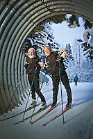 1.2.2012  West High School cross country skiers, Jojo Fleishman and Emily Decker, on the Tony Knowles Coastal Trail at the tunnel under Minnesota Drive near Westchester Lagoon, Anchorage