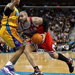 February 12, 2011; New Orleans, LA, USA; Chicago Bulls power forward Carlos Boozer (5) drives past New Orleans Hornets power forward David West (30) during the third quarter at the New Orleans Arena.  The Bulls defeated the Hornets 97-88. Mandatory Credit: Derick E. Hingle