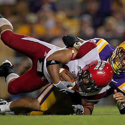 19 September 2009: LSU Tigers defensive end Rahim Alem (84) tackles Louisiana-Lafayette Cajuns running back Undrea Sails (31) during 31-3 win by the LSU Tigers over the University of Louisiana Lafayette Ragin' Cajuns at Tiger Stadium in Baton Rouge, Louisiana.