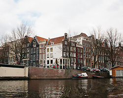 Architecture in Amsterdam as seen from a canal.