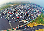 BEIJING, CHINA - OCTOBER 06: (CHINA OUT) <br /> Travel Peak Appears On Beijing-Hong Kong-Macau Expressway At End Of Chinas National Day Holiday<br /> <br /> Aerial view of cars queuing up to pass a checkpoint set recently in the direction of Beijing on the Beijing-Hong Kong-Macau Expressway at the end of National Day Holiday on October 6, 2015 in Beijing, China. A travel peak appeared at the end of 7-day China\'s National Day Holiday. <br /> ©Exclusivepix Media