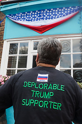 © Licensed to London News Pictures. 13/07/2018. London, UK.  A man with a Trump supporter tee shirt at the Donald Trump special relationship evening and welcome party held at  the Trump Arms Pub (formerly known as Jameson Pub) in Hammersmith, west London. The pub has been decked out with American flags and banners celebrating Donald Trump's arrival in the UK..  Photo credit: Vickie Flores/LNP